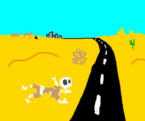Skeleton by roadside in desert