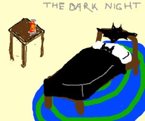 Batman Sleeping next to Lava Lamp on End Table