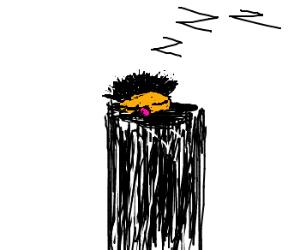 Ernie sleeping in Oscar the Grouch's trashcan