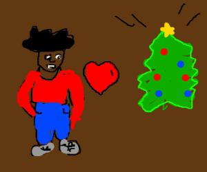 black man loves christmas tree