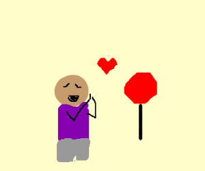 Bald black guy loves the stop sign.