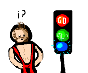 Muscular man is confused by stop lights.