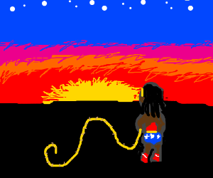 Black Wonder Woman watches sunset.