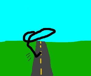 Karate black belt kicks the surface of road