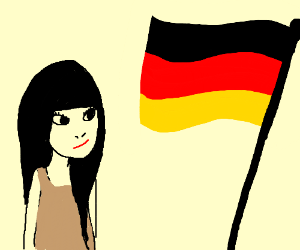 Pretty brunette girl looks at the German flag.