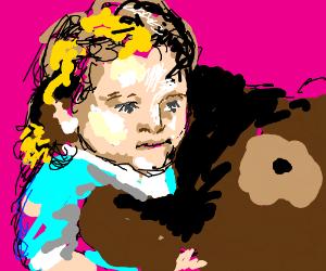 girl hugs big teddy bear