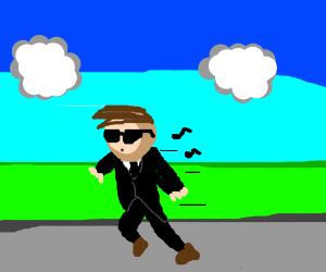 Man in a suit walking by