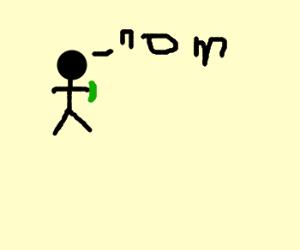 man eats pickle