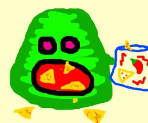 green blob eats spicy nachos