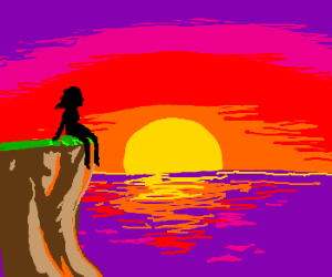 Figure watching sunset from cliff above ocean.