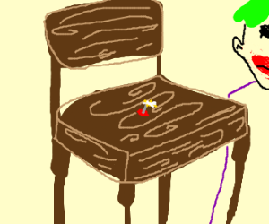 Some joker has put a tack on a chair.