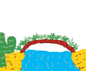 bridge in desert with shrubberies