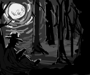 Cowboy sitting in the forest at night