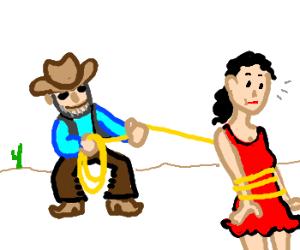 Cowboy lasso's pretty lady