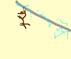 Indiana Jones ziplines down an electrical wire