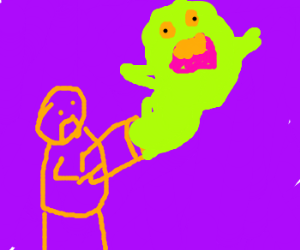 Ghostbuster tries to capture Slimer.