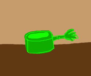 a green sauce pan with an arm