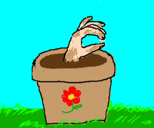 A green pot with a hand covered in mud