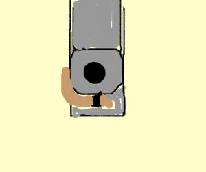 Thug stares down a gun.