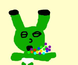 Shrek baby snoozes Skittles.
