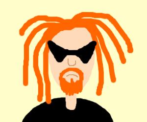 man has orange goatee and dreads/ rocker