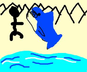 guy is walking w/ shark in mountains near lake