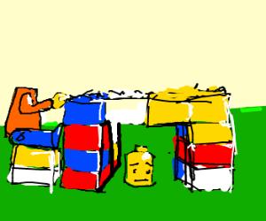 LEGOman hides head under table in shame