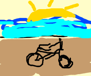 Man riding bike on the beach; It's sunrise