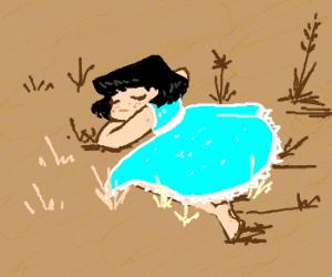 Little girl in blue dress sleeps in meadow