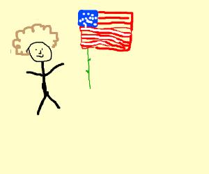 afro man putting american flag on rose stem
