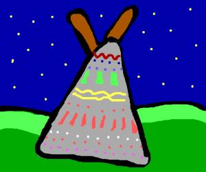 A teepee at night
