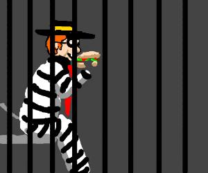 The Hamburglar is behind bars, but happy.