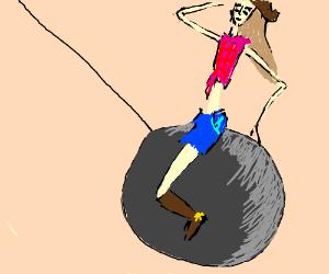 A cowgirl riding a wrecking ball