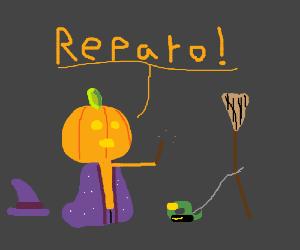 pumpkin wizzard fixing his broom w tape