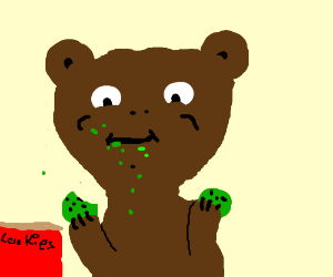 Bear stuffs face with cookies.
