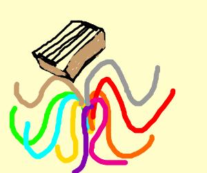 stringbox falls into colorful spaghetti