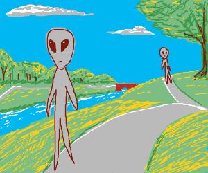 two aliens walking in the park