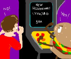 Burgers beat man at Arcade game