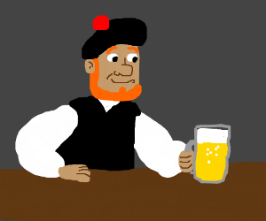 A bearded Scot man is having a nice beer