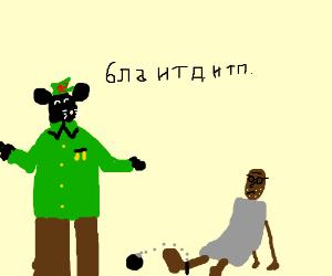 Communist leader,Mickey Mouse, enslaves Gandhi