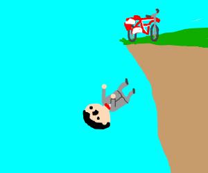 Pee Wee Herman falls of his bike
