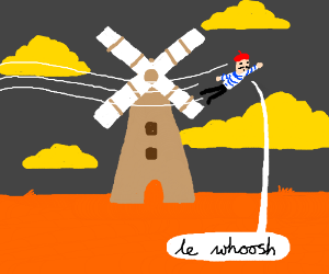 french guy flys past windmill