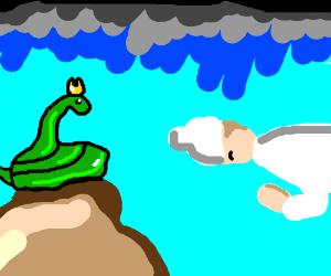 Man worshipping king cobra wearing a crown