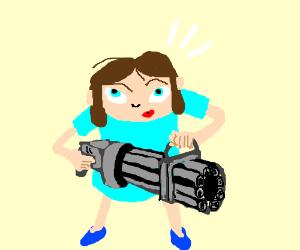 Cute little girl holding a machinegun