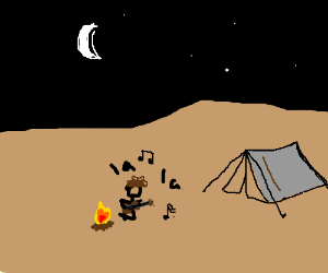 Cowboy sings by campfire