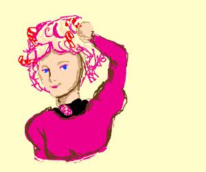 Effie Trinket puts candycanes in her pink hair