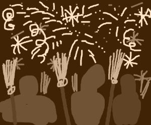 Broom enthusiasts enjoy a fireworks display.