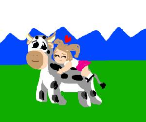 Girl hugs a cow