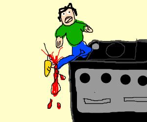 man breaks his leg while climbing a gamecube