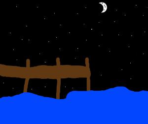Wooden pier at night